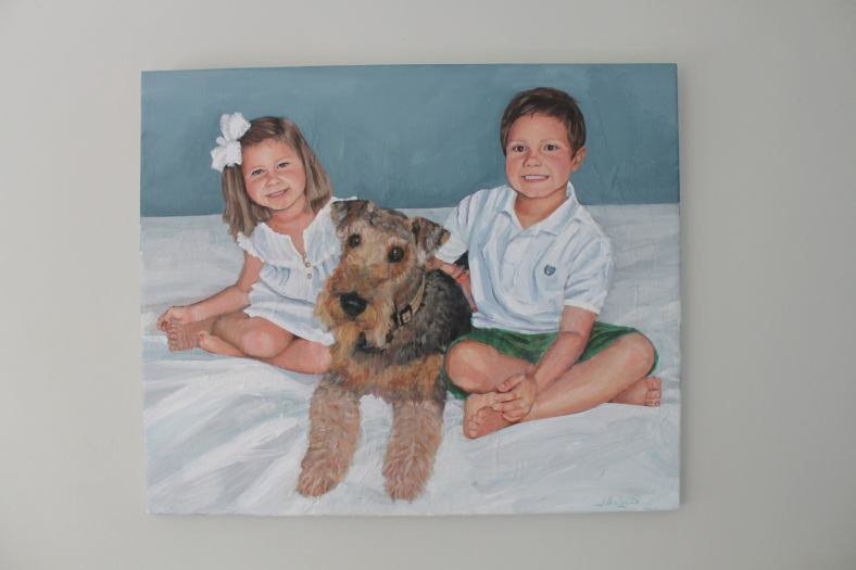family portrait of children with their dog